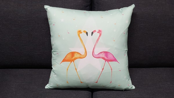Decorative pillow with flamingos in love motif
